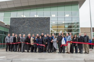 Standing in front of the new administration building, bridge staff, Sault Ste. Marie Bridge Authority board members,  construction team members and other dignitaries cut a ceremonial ribbon for the new $8.9 million (USD)  toll plaza project at the International Bridge. (MDOT photo)