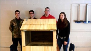 Caption info: The main Baraga Area Schools student workers who completed the nest box build, from left, Zach Sackett, Caleb Hansen, Alan DesRoucher, and Lacey Sterbenz, stand with their completed project. (John Filpus photo)